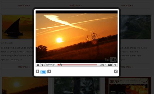 Figura 31 – Dettaglio dell'apertura di un video tramite un effetto lightbox